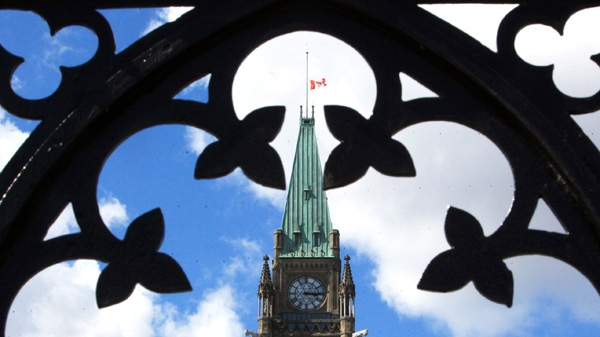 The flag on the Peace Tower flies at half-mast in tribute to NDP leader Jack Layton on Parliament Hill in Ottawa, Monday, Aug. 22, 2011. (Fred Chartrand / THE CANADIAN PRESS)