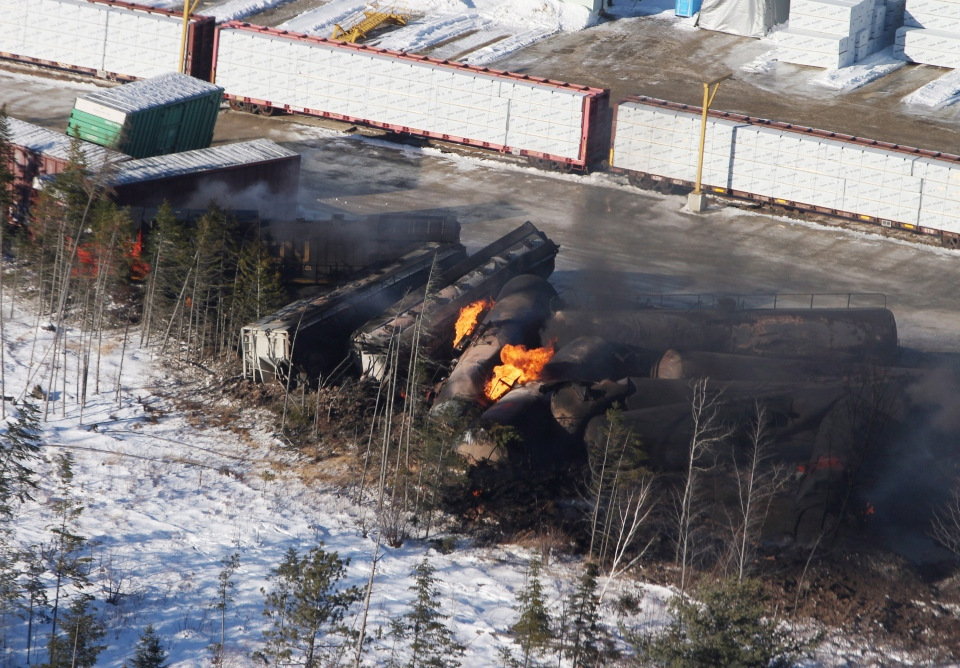 Derailed train cars burn in Plaster Rock, N.B., Wednesday, Jan. 8, 2014. (Tom Bateman / THE CANADIAN PRESS)
