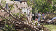Residents clean up tornado damage in Goderich, Ontario on Monday August 22, 2011. (Frank Gunn / THE CANADIAN PRESS)