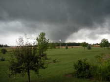 A suspected tornado is visible in Benmiller, Ont., just north east of Goderich, Sunday, Aug. 21, 2011. (Joe Gowanlock for CTV News)