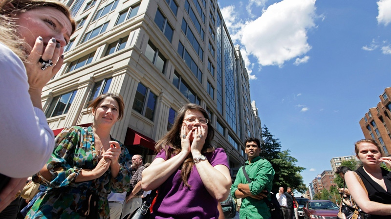 Office workers gather on the sidewalk in downtown Washington, Tuesday, Aug. 23, 2011, moments after a 5.9 magnitude tremor shook the city. (AP / J. Scott Applewhite)