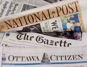 Some of Postmedia's newspapers are displayed in Ottawa on Jan. 8, 2010. (THE CANADIAN PRESS / Adrian Wyld)
