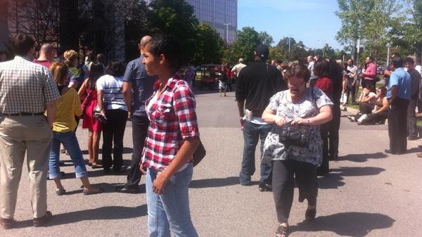 office workers are evacuated after a magnitude 5.9 earthquake is felt in Markham, Ont., on Tuesday, Aug. 23, 2011. (Aimee Jessop for CTV News)