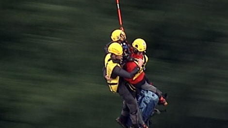 Coquitlam Search and Rescue members used a helicopter long line to rescue three stranded hikers near Pitt Lake, B.C., on Aug. 23, 2011.