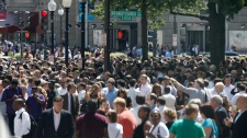 People crowd Pennsylvania Avenue in Washington, Tuesday, Aug. 23, 2011, as they evacuate buildings after an earthquake his the in Washington area. (AP / Charles Dharapak)