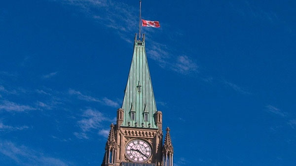 The flag atop the Peace Tower in Ottawa flies at half-mast following the death of Jack Layton, Tuesday, Aug. 22, 2011.