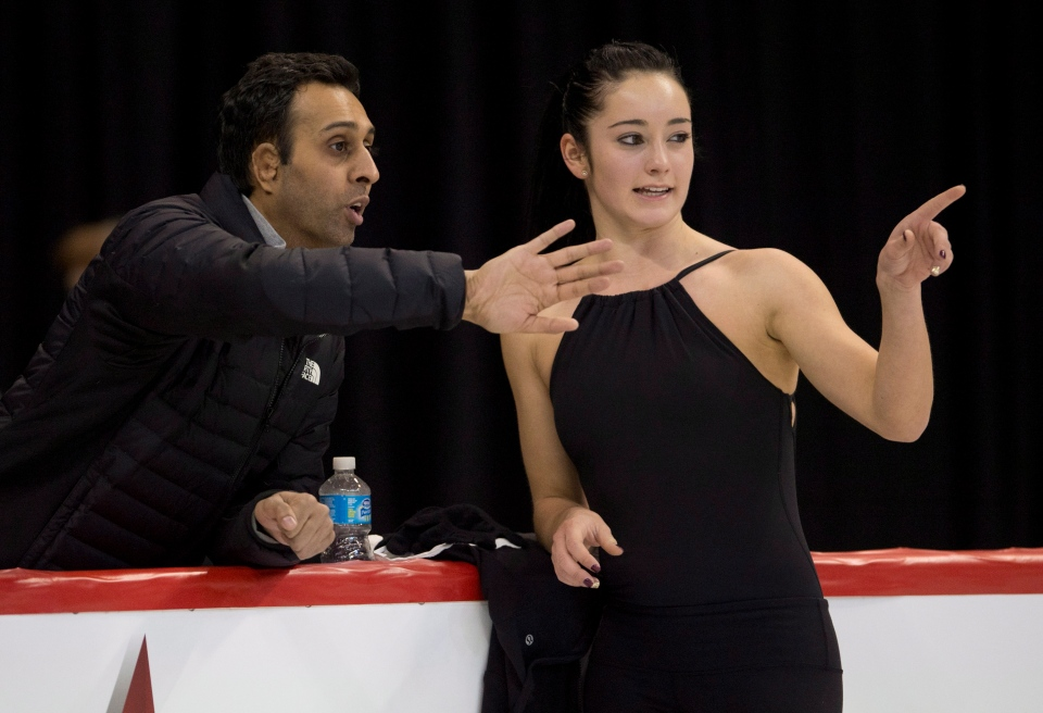 Canadian figure skater Kaetlyn Osmond speaks with her coach Ravi Walia during the Senior Women's practice at the Canadian Skating Championships Thursday January 9, 2014 in Ottawa. (THE CANADIAN PRESS/Adrian Wyld)