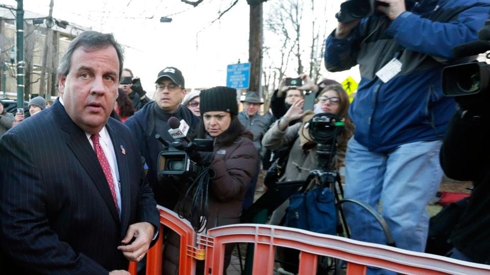 New Jersey Gov. Chris Christie, second left, arrives at Fort Lee, N.J., City Hall, Thursday, Jan. 9, 2014. (AP / Richard Drew)