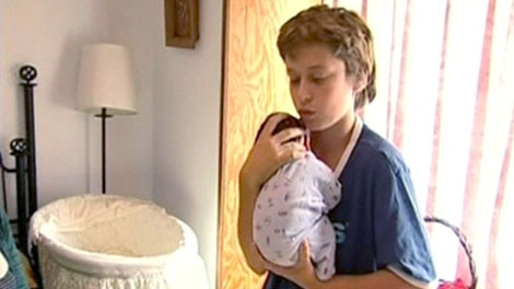 Twelve-year-old Gaelan Edwards of Campbell River, B.C. is seen with his newborn baby brother.