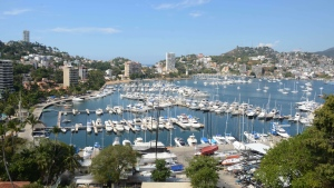 In this Tuesday, Jan. 7, 2014 photo, yachts are docked at a marina in the Bay of Acapulco, Mexico. (AP / Bernandino Hernandez)