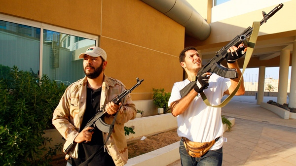 Libyan rebels patrol to try and find Moammar Gadhafi's relatives as they got rumors that one of his son was hiding inside, in Tripoli, Libya, Wednesday, Aug. 24, 2011. (AP / Francois Mori)