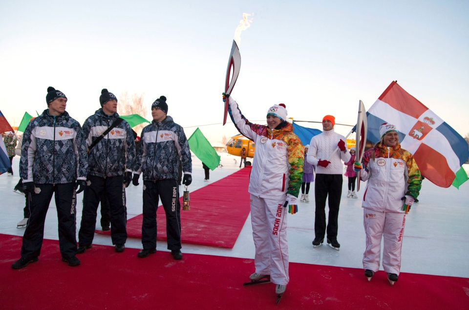 Olympic torch bearer Svetlana Vysokova holds an Olympic torch during the torch relay in Kungur, Perm region, Russia, Friday, Jan. 3, 2014. (Olympictorch2014.com)