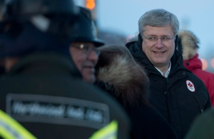 Prime Minister Stephen Harper greets workers at the construction site of the Inuvik to Tuktoyaktuk highway in Inuvik, N.W.T., Wednesday, Jan. 8, 2014. (Jonathan Hayward / THE CANADIAN PRESS)