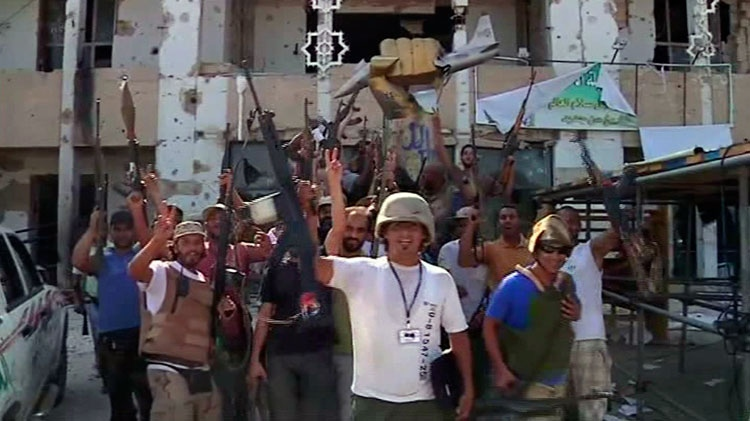 Rebels celebrate in Moammar Gadhafi's Bab al-Aziziya fortress-like compound in Tripoli, Wednesday, Aug. 24, 2011.