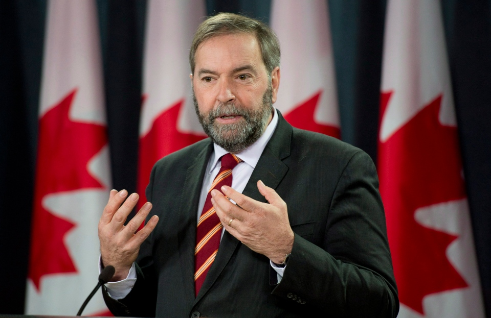 NDP leader Thomas Mulcair speaks with the media during an end of session availability in Ottawa, Wednesday, Dec. 18, 2013. (Adrian Wyld / THE CANADIAN PRESS)