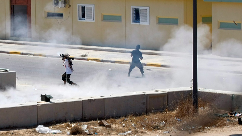 Libyan rebels continue to fight inside Moammar Gadhafi's compound Bab al-Aziziya in Tripoli, Libya, early Wednesday, Aug. 24, 2011. (AP / Francois Mori)