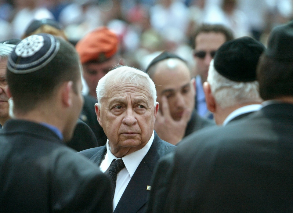 Marking Israeli Memorial Day, Israeli Prime Minster Ariel Sharon greets family members of terror victims on Monday, April 26, 2004. (AP / Brennan Linsley)