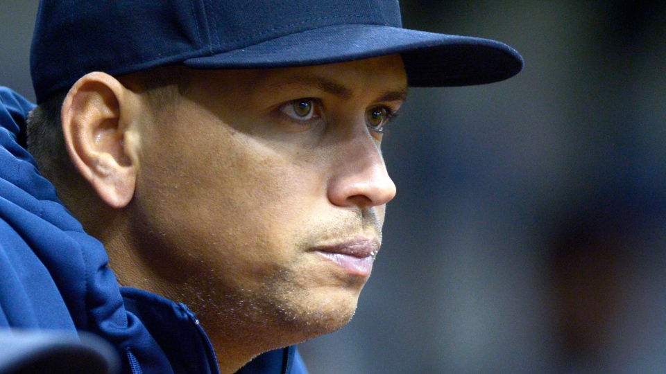 New York Yankees' Alex Rodriguez watches from the dugout during the first inning of a baseball game against the Tampa Bay Rays in St. Petersburg, Fla. on Aug. 25, 2013. (AP / Phelan M. Ebenhack)