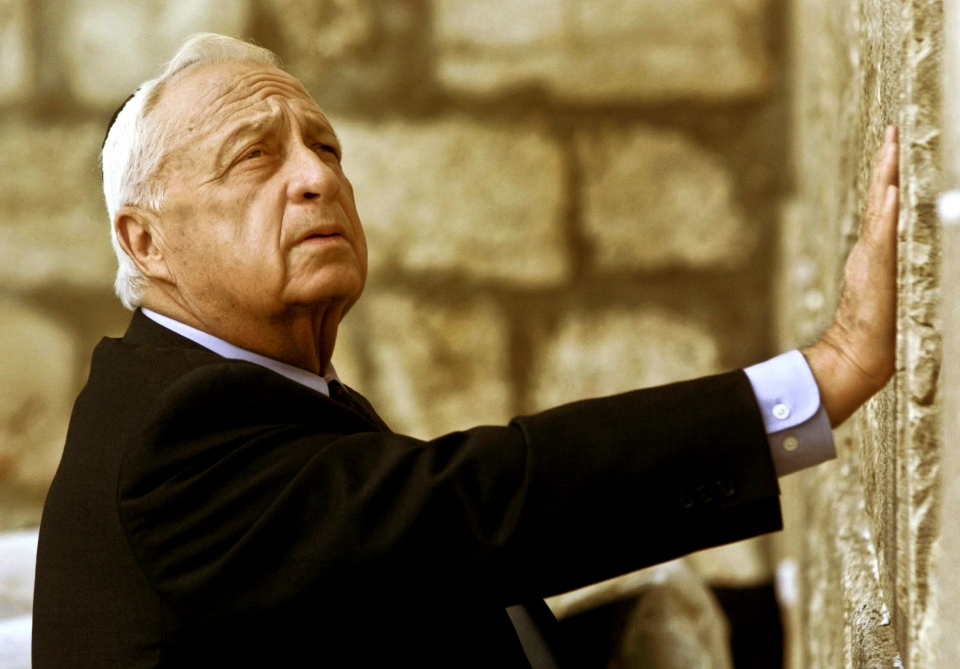 Ariel Sharon, then Israel's Prime Minister-elect, looks up as he touches Judaism holiest site, the Western Wall, in Jerusalem on Wednesday Feb. 7, 2001.  (AP / David Guttenfelder)