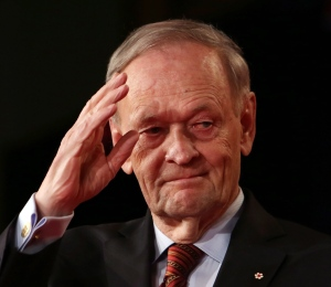 Former prime minister Jean Chretien saluts after addressing the Liberal Party leadership in Ottawa, Sunday April 14, 2013. (Fred Chartrand / THE CANADIAN PRESS)