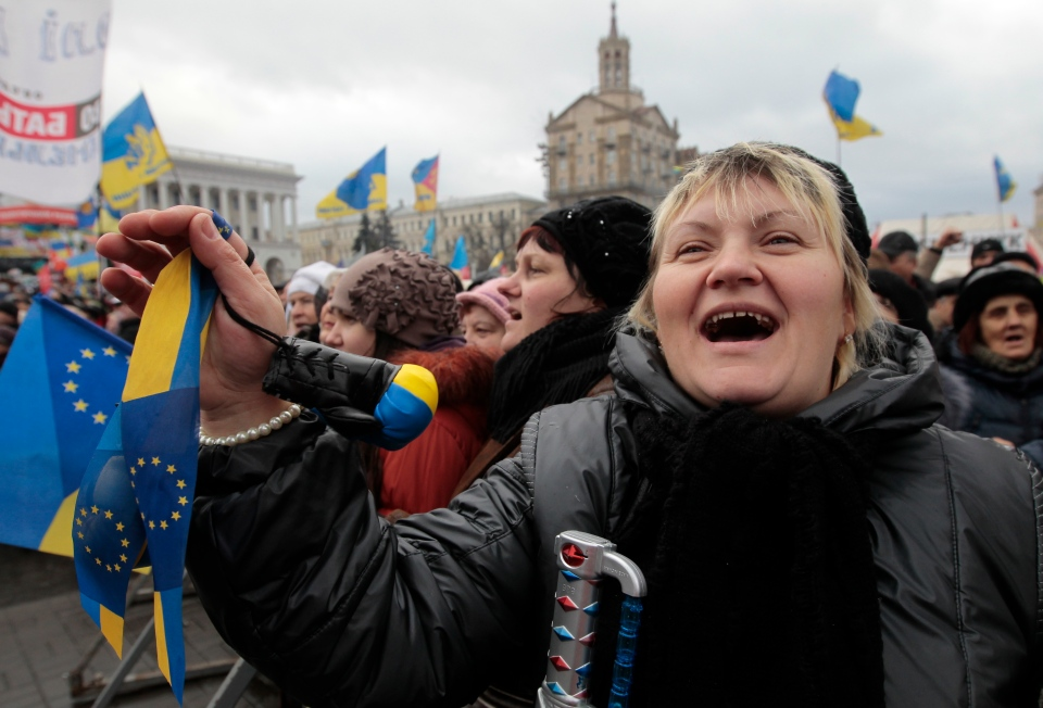 A pro-European Union activist shouts a slogan during a rally in Independence Square in Kyiv, Ukraine, on Jan. 12, 2014. (AP Photo/Sergei Chuzavkov)