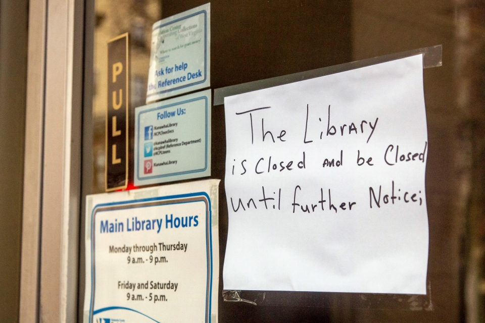 The ban on serving tap water affects even businesses like the public library in Charleston, W.Va., following a chemical spill earlier this week. (AP Photo/Michael Switzer)