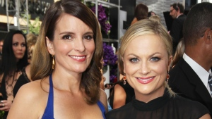 Tina Fey, left, and Amy Poehler arrive at the 65th Primetime Emmy Awards at Nokia Theatre in Los Angeles on Sept. 22, 2013. (Invision for Academy of Television Arts & Sciences / Matt Sayles)
