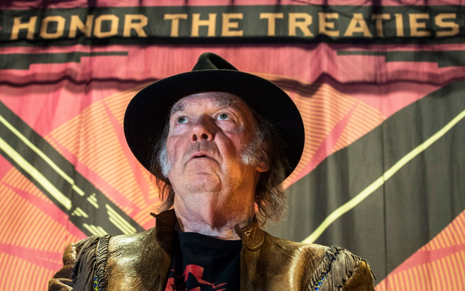 Singer Neil Young speaks during a press conference for the 'Honour the Treaties' tour in Toronto Sunday, Jan. 12, 2014. (Mark Blinch / THE CANADIAN PRESS)