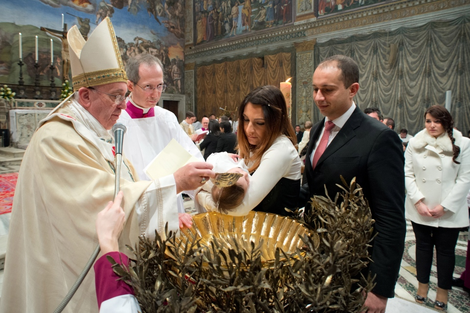In this photo provided by the Vatican paper L' Osservatore Romano, Pope Francis baptizes a child at the Vatican, Sunday, Jan. 12, 2014.  (AP Photo/L'Osservatore Romano)