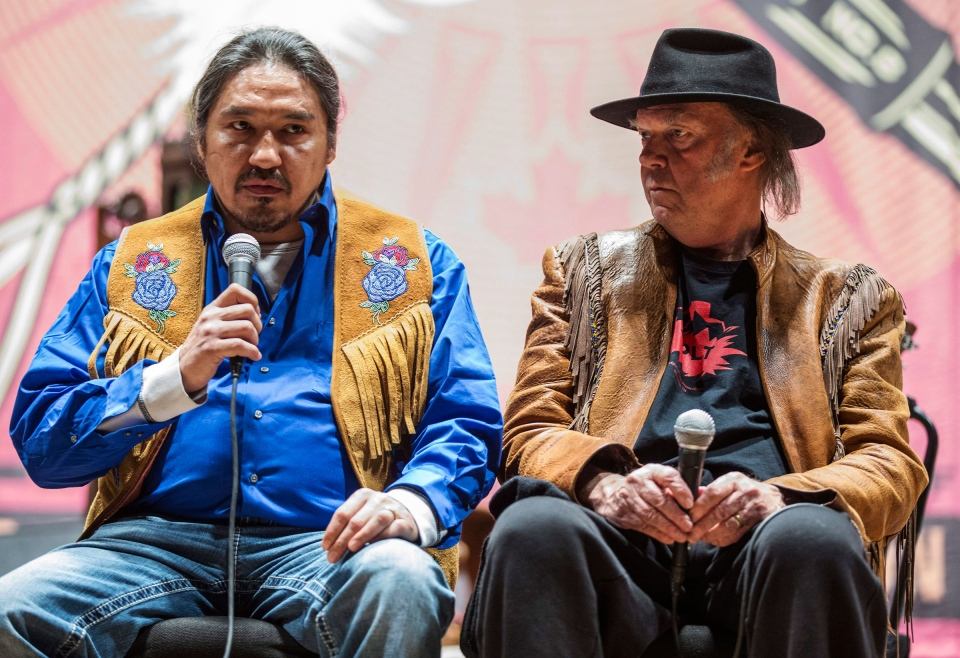"Athabasca Chipewyan Chief Allan Adam, left speaks beside singer Neil Young at a press conference for the ""Honour the Treaties"" tour, a series benefit concerts being held to raise money for legal fight against the expansion of the Athabasca oilsands in northern Alberta and other similar projects, in Toronto, Sunday Jan. 12, 2014. (Mark Blinch / THE CANADIAN PRESS)"