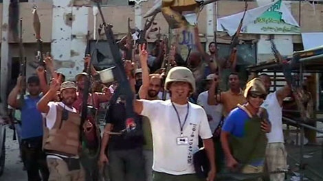 Rebels celebrate in Moammar Gadhafi's Bab al-Aziziya fortress-like compound in Tripoli, Wednesday, Aug. 24, 2011.