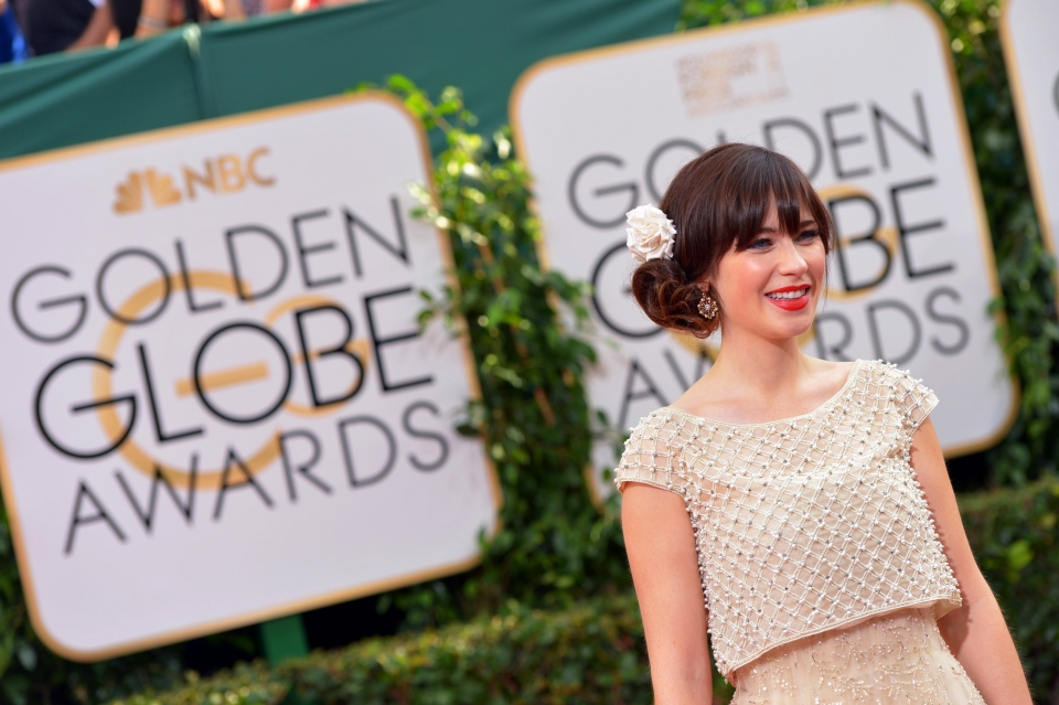Zooey Deschanel arrives at the 71st annual Golden Globe Awards at the Beverly Hilton Hotel on Sunday, Jan. 12, 2014, in Beverly Hills, Calif. (Photo by John Shearer/Invision/AP)