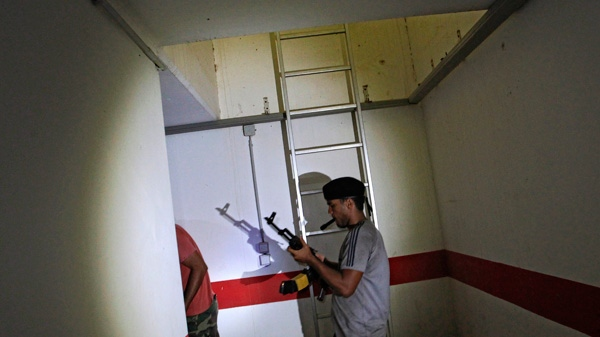 Rebel fighters are seen in a bunker of Moammar Gadhafi main compound in Bab al-Aziziya in Tripoli, Libya, Thursday, Aug. 25, 2011. (AP / Sergey Ponomarev)