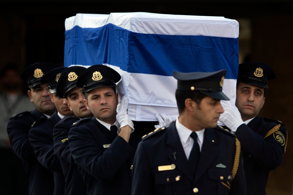 Members of the Knesset guard carry the coffin of late Israeli Prime Minister Ariel in Jerusalem on Jan. 13, 2014. Israel is holding a state memorial ceremony for the former Prime Minister Ariel Sharon at the country's parliament building. (AP Photo/Bernat Armangue)