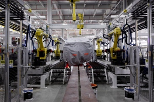 A vehicle sits in part of the new paint shop at Chrysler's Sterling Heights Assembly Plant in Sterling Heights, Mich., on July 16, 2013. (AP Photo/Paul Sancya)