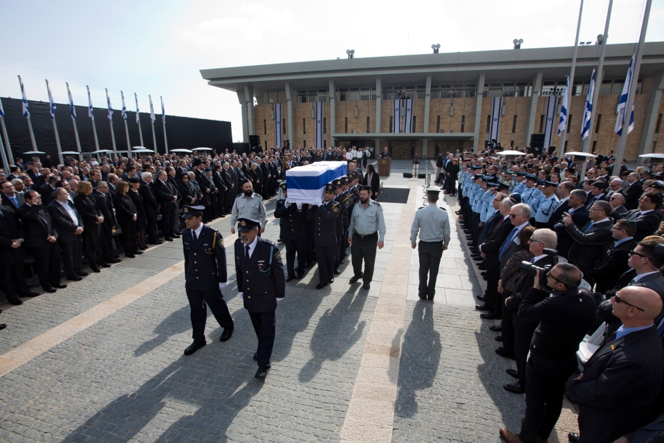 The coffin of late Israeli Prime Minister Ariel Sharon is carried after a memorial ceremony outside the Knesset, in Jerusalem, Monday, Jan. 13, 2014. (AP / Sebastian Scheiner)