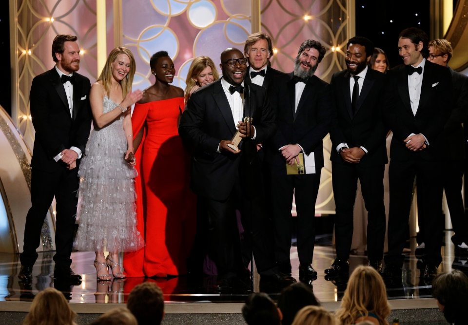 Steve McQueen, centre, accepts the award for best motion picture drama for '12 Years a Slave' during the 71st annual Golden Globe Awards at the Beverly Hilton Hotel in Beverly Hills, Calif., on Sunday, Jan. 12, 2014.
