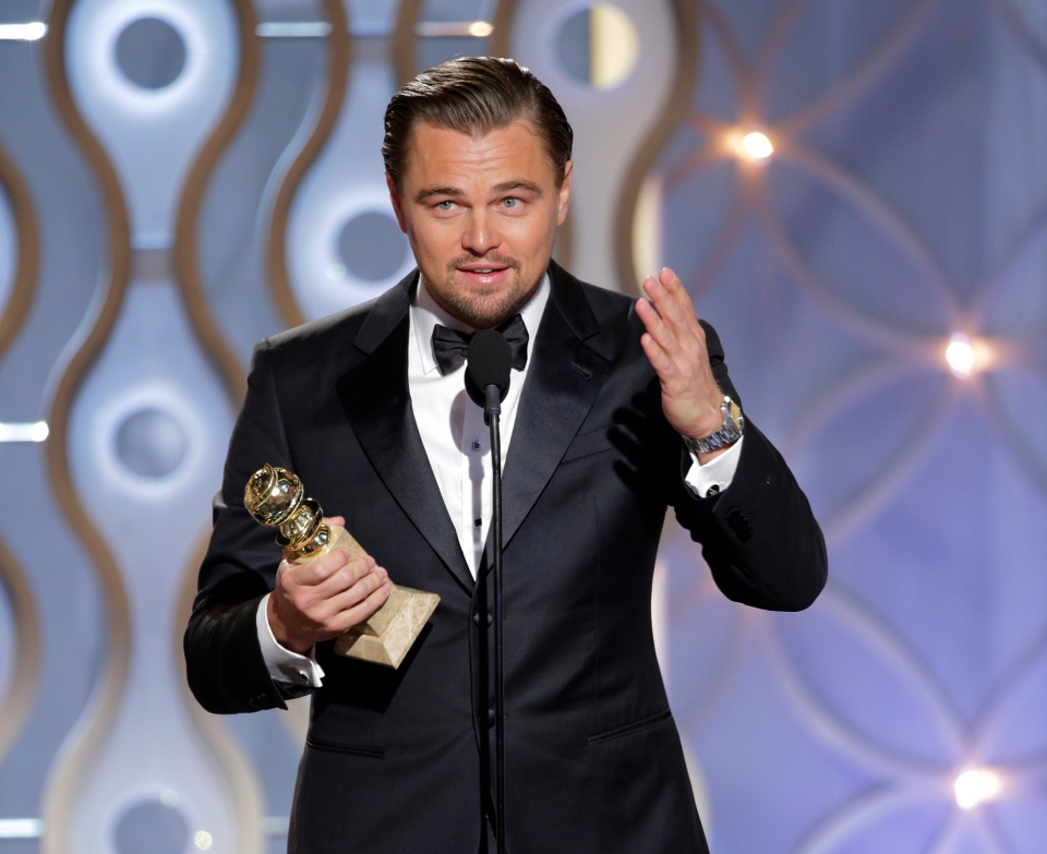 Leonardo DiCaprio accepts the award for best actor in a motion picture comedy for his role in 'The Wolf of Wall Street' during the 71st annual Golden Globe Awards at the Beverly Hilton Hotel on Sunday, Jan. 12, 2014.
