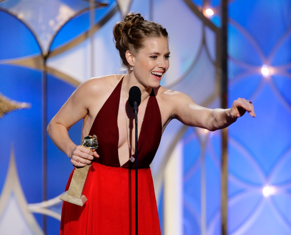 Amy Adams accepts the award for best actress in a motion picture, musical or comedy for her role in, 'American Hustle' during the 71st annual Golden Globe Awards at the Beverly Hilton Hotel in Beverly Hills, Calif., Sunday, Jan. 12, 2014.