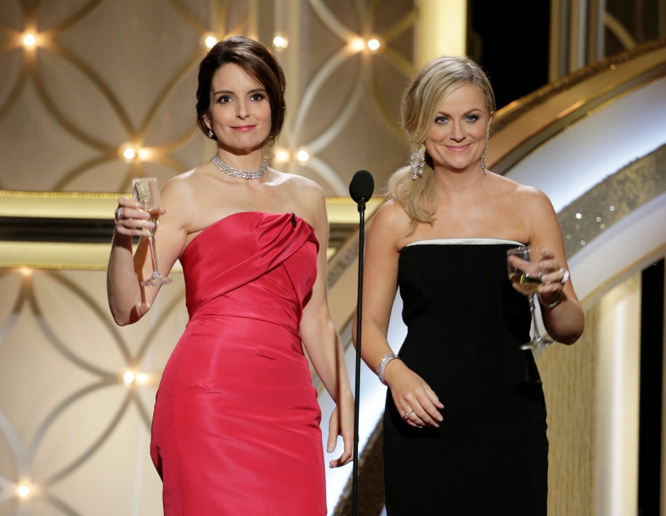 Hosts Tina Fey, left, and Amy Poehler raise their glasses during the 71st annual Golden Globe Awards at the Beverly Hilton Hotel in Beverly Hills, Calif., Sunday, Jan. 12, 2014.