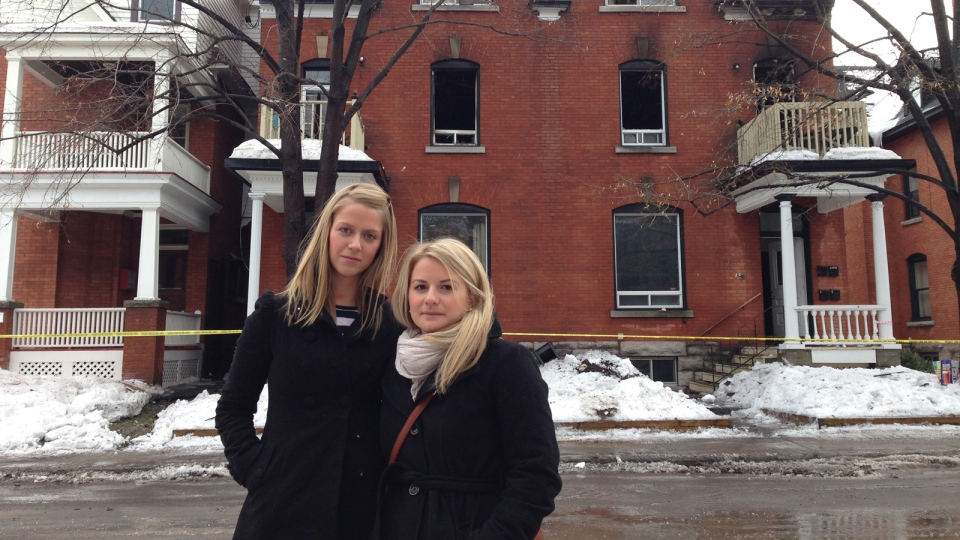 Displaced Residents Jennifer White, 26, And Stephanie Thompson, 25, Stand  Outside Their Burned Out Apartment At 544 Gilmour Street.