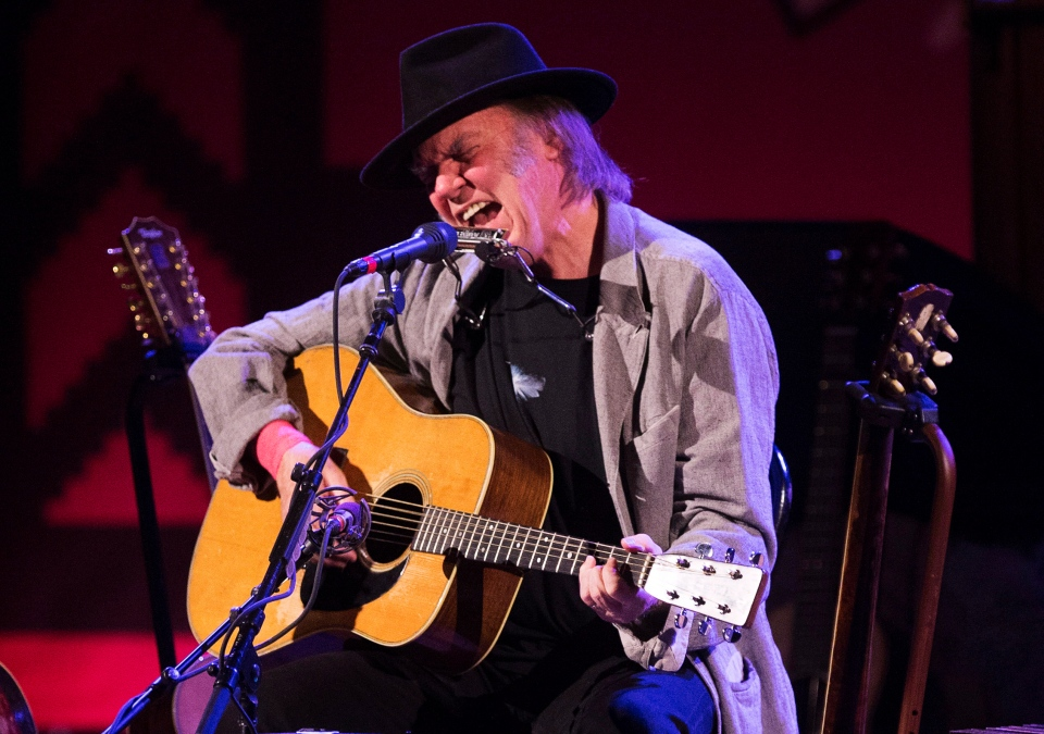 Neil Young performs during the 'Honour the Treaties' tour, a series of benefit concerts being held to raise money for legal fight against the expansion of the Athabasca oilsands in northern Alberta and other similar projects, in Toronto, on Sunday, Jan. 12, 2014. (The Canadian Press/Mark Blinch)