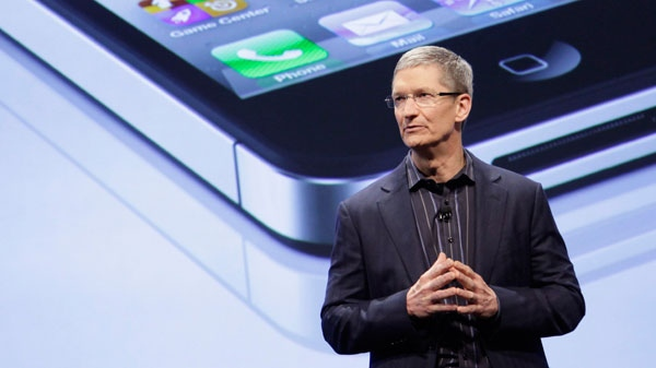 In this photo taken Jan. 11, 2011, Tim Cook announces that Verizon Wireless will carry Apple's iPhone, in New York. (AP / Mark Lennihan)