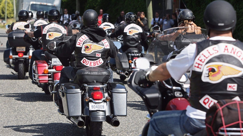Quebec members of the Hell's Angels motorcycle gang arrive at the White Rock, B.C., chapter's property in Langley, B.C., on Friday July 25, 2008. (Darryl Dyck / THE CANADIAN PRESS)