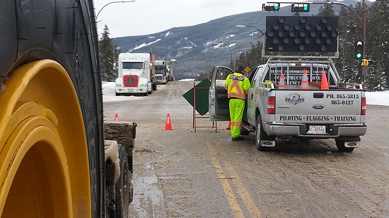 Roads are closed off after an avalanche triggered a large landslide, which has blocked Highway 16 near Mount Robson, on the Alberta-B.C. boundary on Monday, Jan. 13, 2014.