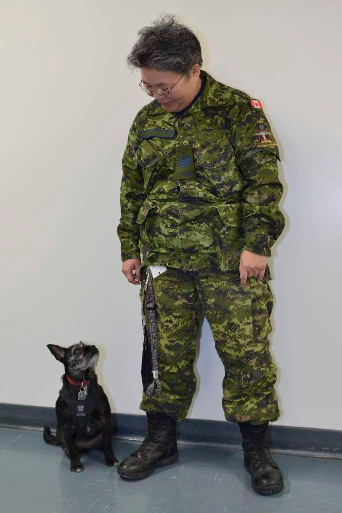 Sgt. Shirley Jew and her service dog Snoopy. Jew, an Alberta soldier with post-traumatic stress disorder, says she's disappointed Air Canada wouldn't allow her dog on board a plane as a service animal. (Canadian Armed Forces / Handout)