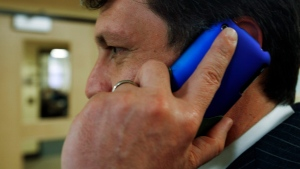 A man talks on his cellphone in this file photo. (AP Photo/Pat Wellenbach, File)