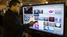 Sami Smidi demonstrates an internet capable TV