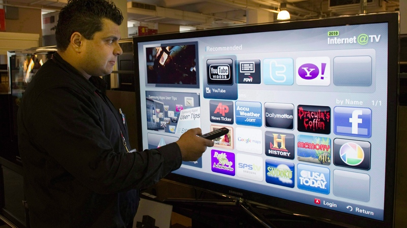 Sami Smidi demonstrates an internet capable TV Wednesday, January 12, 2011 in Montreal. (The Canadian Press Images/Ryan Remiorz)