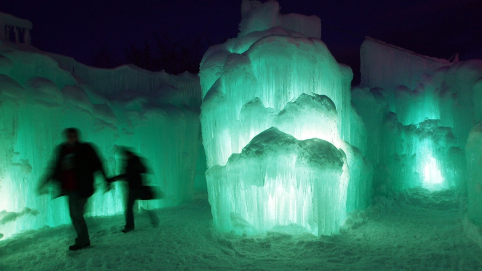 Patrons tour an ice castle at the base of the Loon Mountain ski resort in Lincoln, N.H., Wednesday, Jan. 8, 2014. (AP / Jim Cole)
